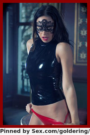 lady slowly removes latex panties