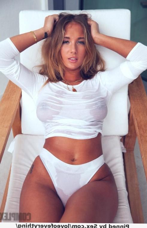 Blonde beauty in wet top and high waist panties