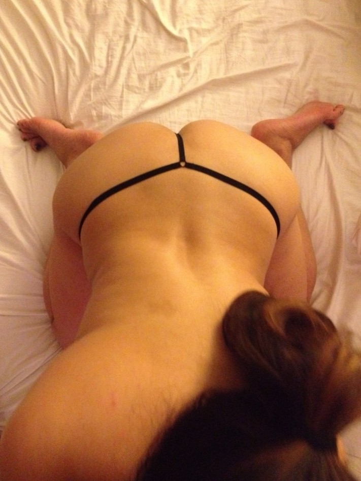 Her fat ass in a black g-string