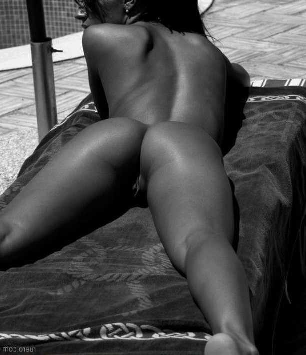 Laying out naked.