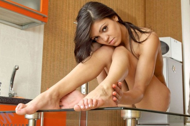 Beauty getting nude on the table